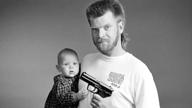 Gun pointed at baby