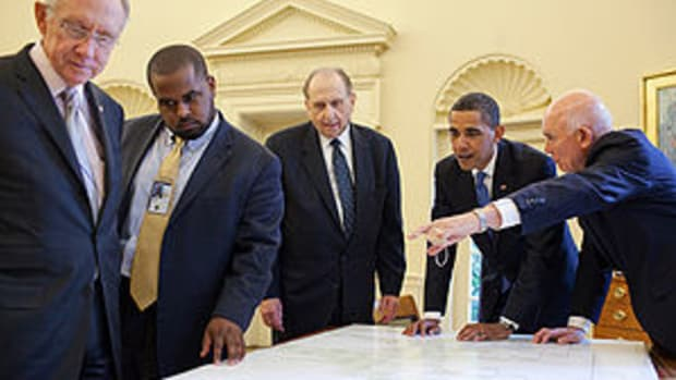 President looks at a genealogy chart in the Ov...