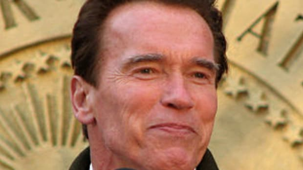 Arnold Schwarzenegger speaking at the lighting...