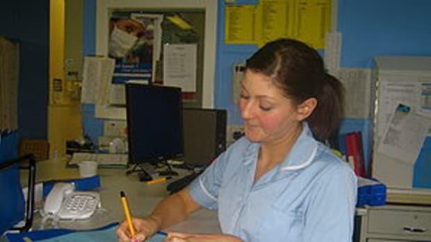 British nurse in nurses' station.
