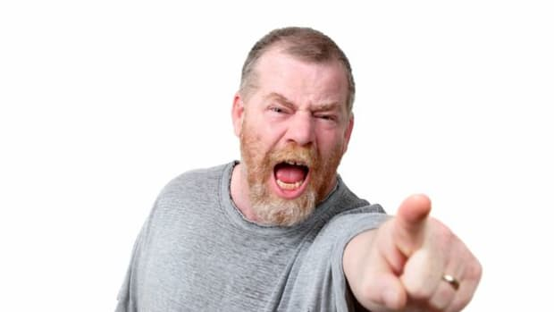 Angry-man-shouting-and-pointing-to-camera-studio-shot