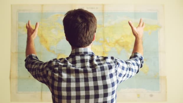 Man Looking At World Map