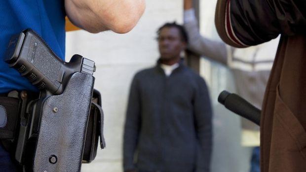 Policemen. Convict. African man. Arrest