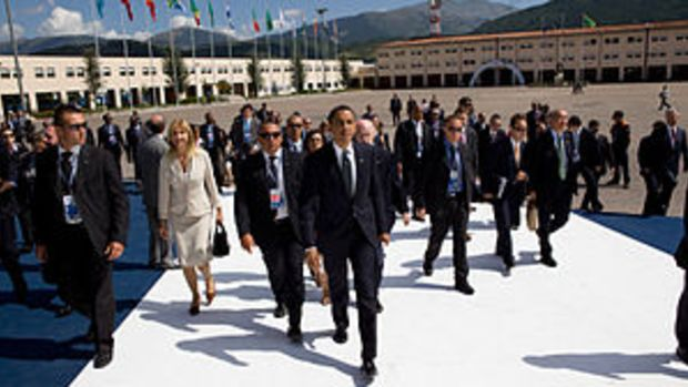 President Barack Obama walks through the G-8 s...