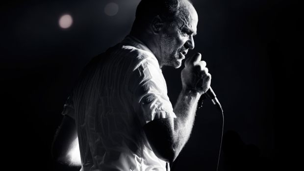 ARTS_The_Tragically_Hip-Flickr-THE_TRAGICALLY_HIPCC_FLICKR-Gord_Donwey_sings_into_microphone_black_and_white_bw-940x626