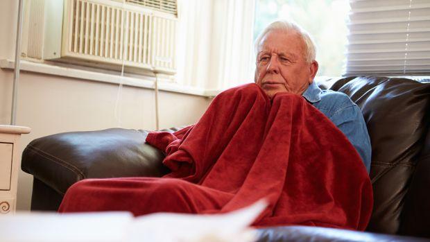 bigstock-Senior-Man-Trying-To-Keep-Warm-65369902