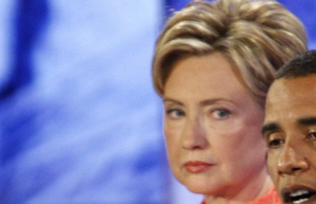 New York Senator Hillary Clinton (L) lis