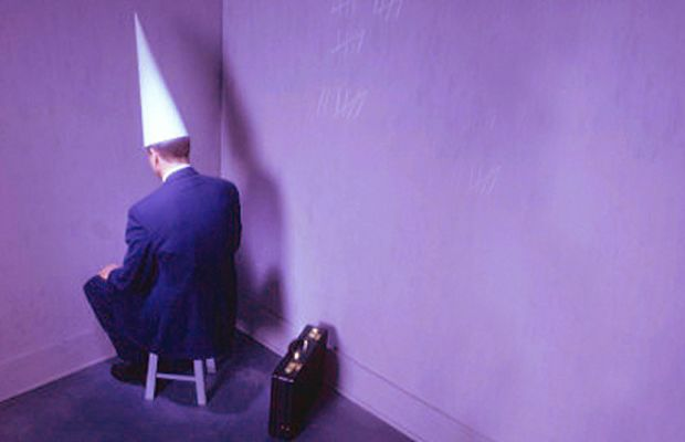 businessman-sitting-in-corner-with-dunc