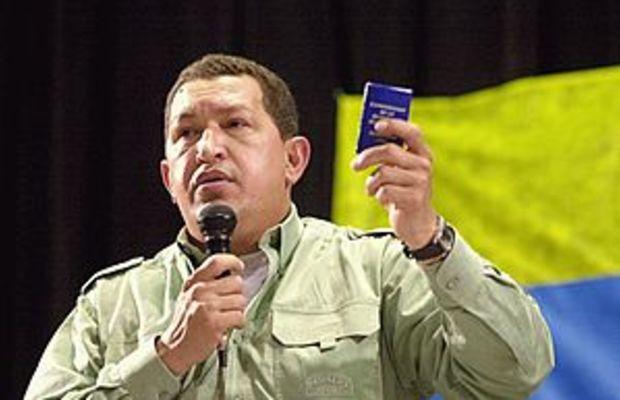 Chávez holds a miniature copy of the 1999 Vene...
