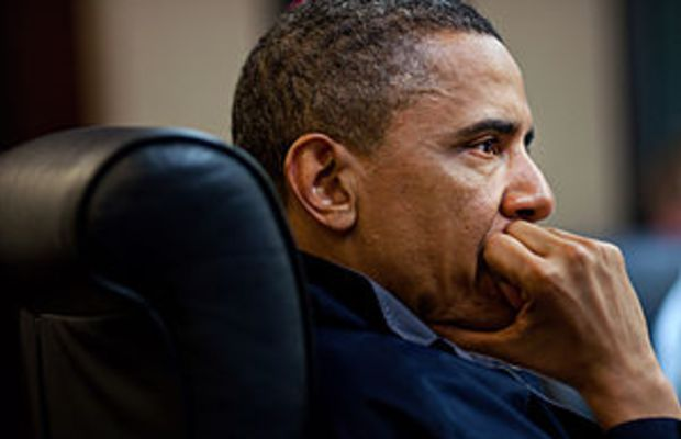 President Barack Obama listens during one in a...