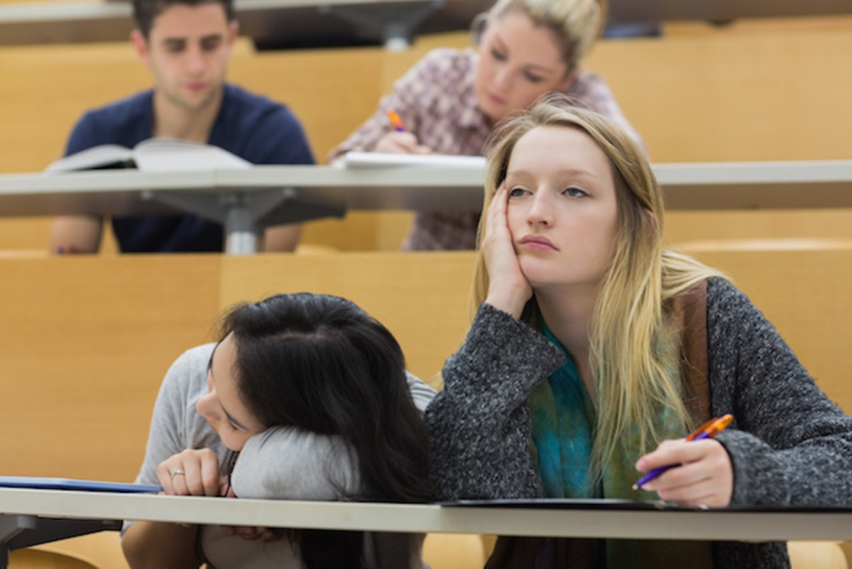 Demotivated students sitting in a lectu