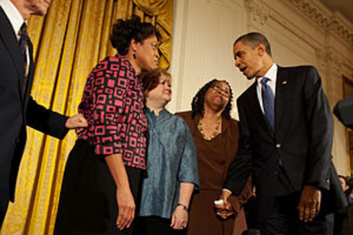 President Barack Obama greets Louvon Harris, l...