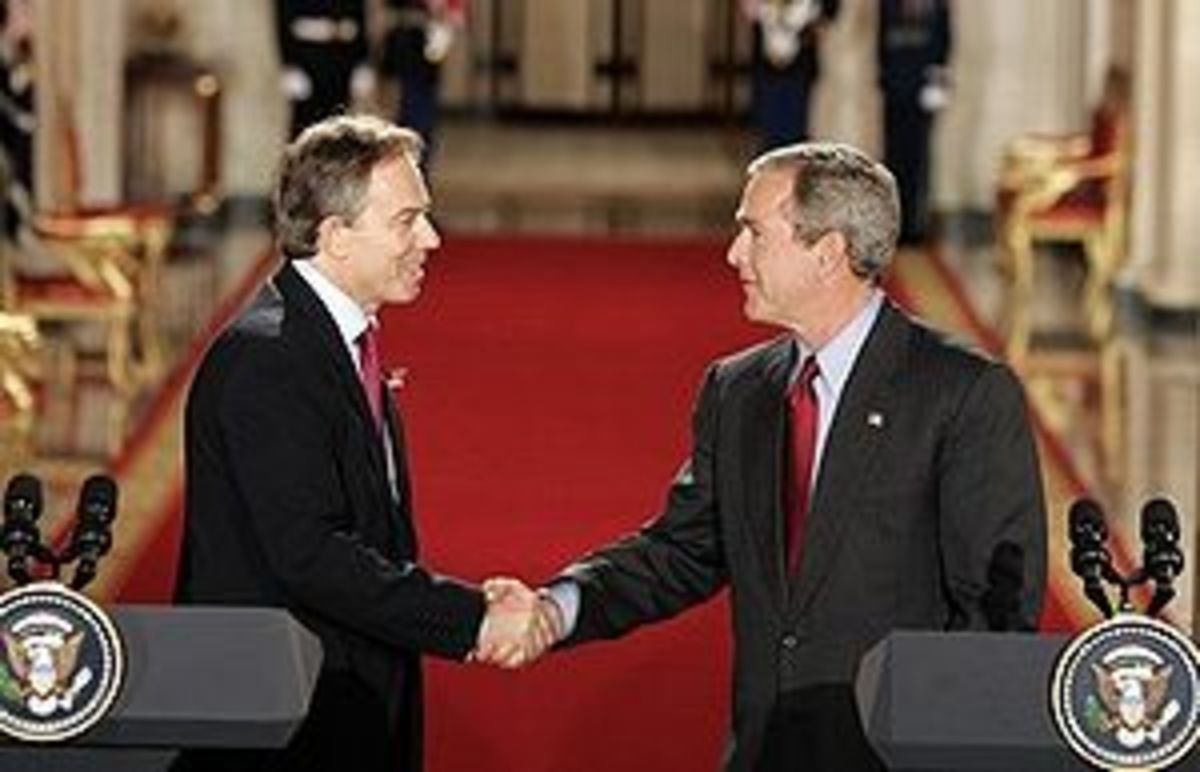 Tony Blair and George W. Bush shake hands afte...
