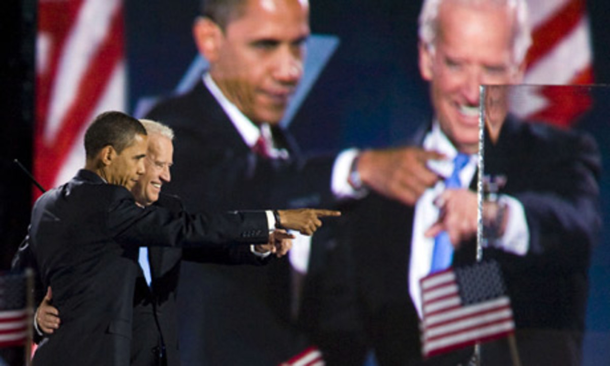 Barack Obama and Joe Biden celebreate their election victory in Chicago
