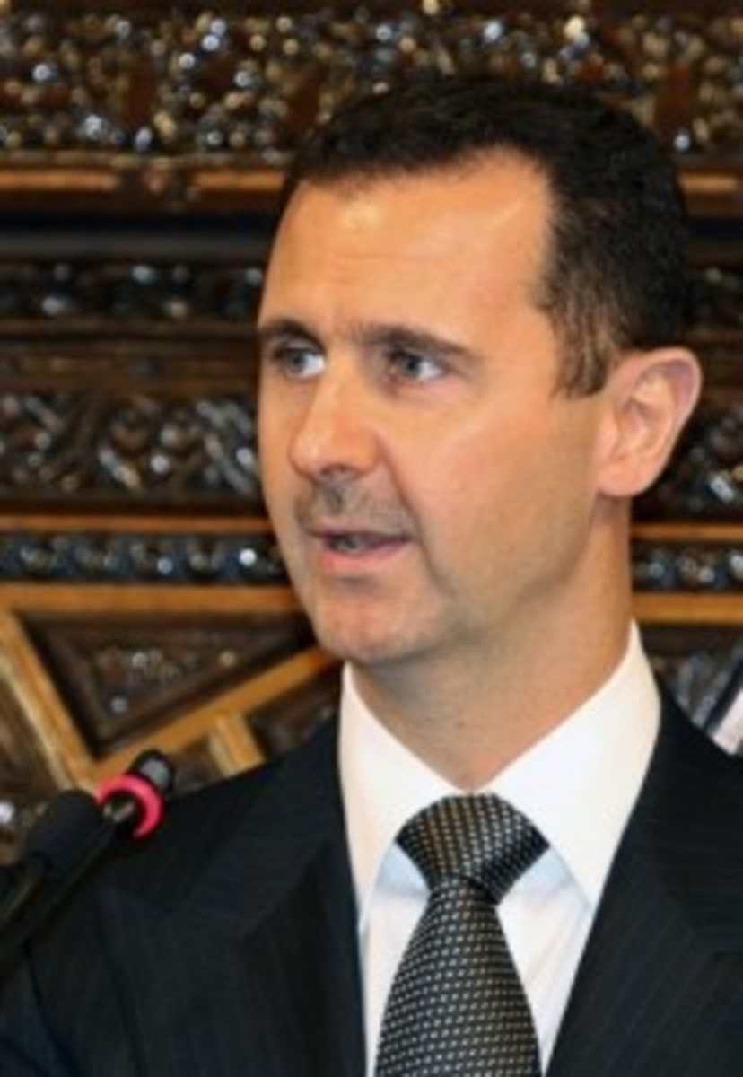 Syria's President Bashar al-Assad delivers a speech to Arab parliamentarians in Damascus