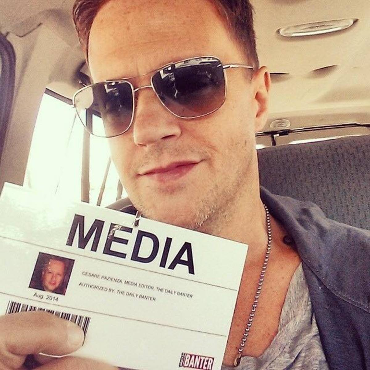 Chez holding the fake media pass we made him for the Ferguson protests