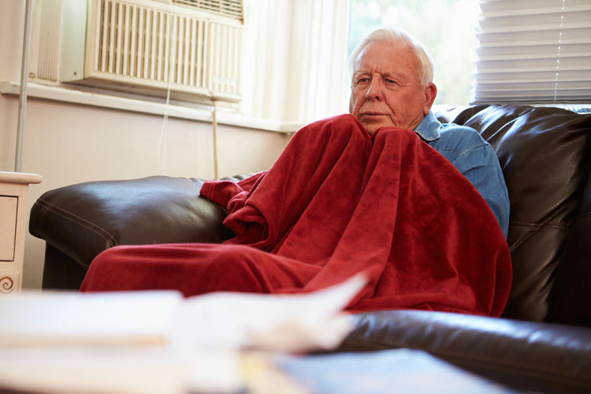 bigstock-Senior-Man-Trying-To-Keep-Warm-65369902